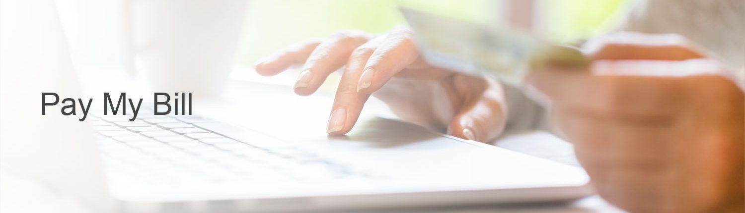 Woman using laptop to pay bill online