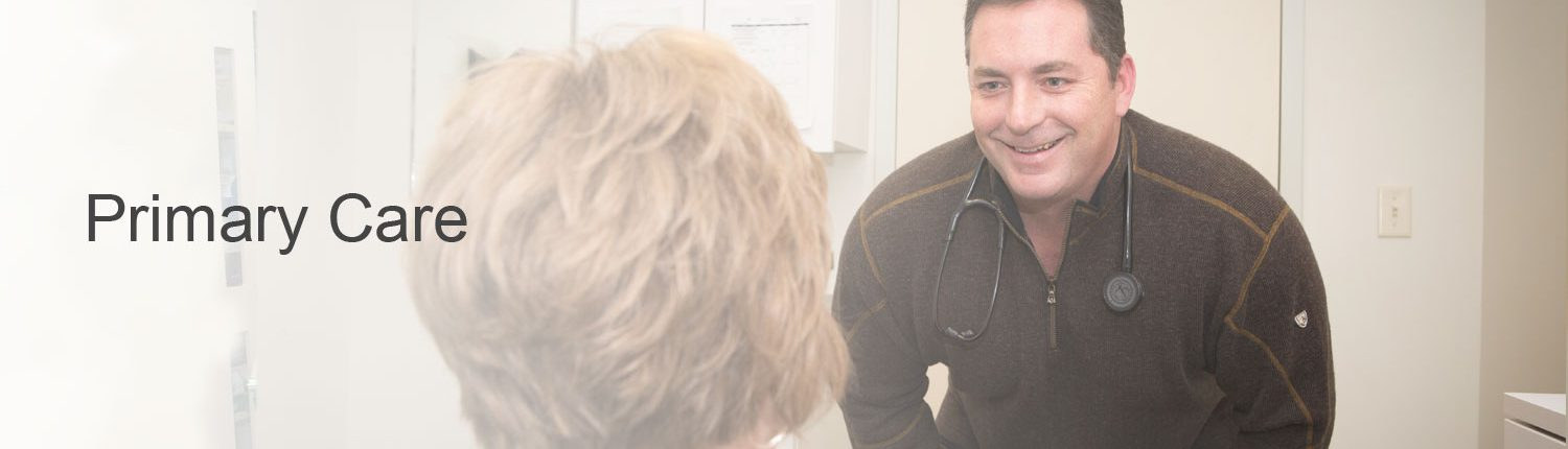 Primary care physician bending over to talk with patient