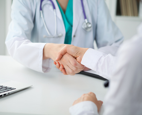 Physician and patient shaking hands